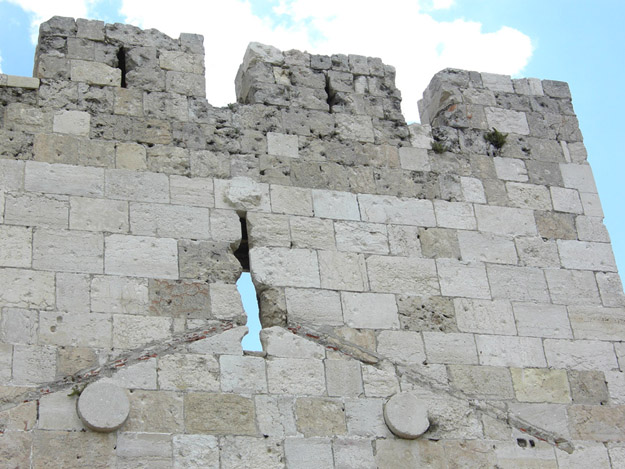 The stones atop Jaffa Gate on the western side of the city walls shows bullet and shell scarring from the 1948 War of Independence.  Jordanian troops held the Old City and the Israelis were desperate to relieve the Jewish Quarter inside.