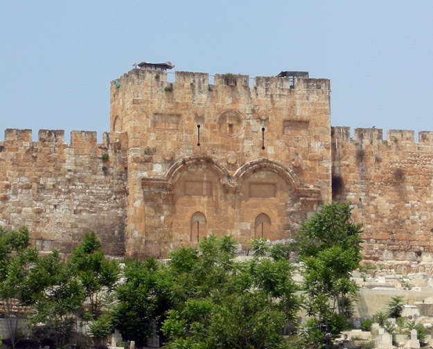 Golden Gate (Bab el-Rahma) in the eastern city wall.  Jewish tradition is that the Messiah will pass through this gate into Jerusalem.  Possibly for that reason the Muslim rulers in the 7th Century closed it up and placed a graveyard in fron of it.