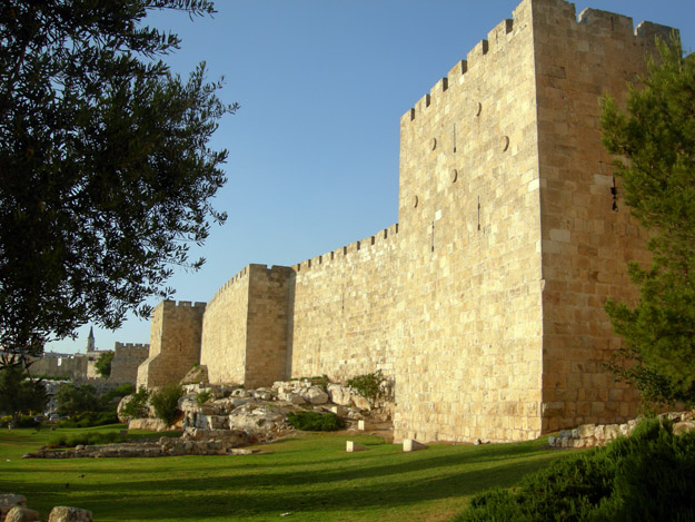 City wall near the Jaffa Gate lit by the setting sun.