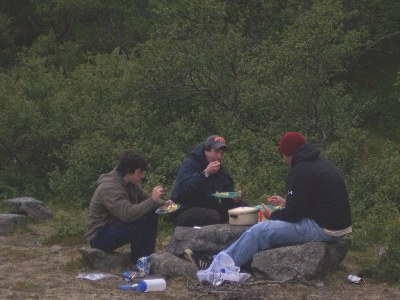 Adam, Rob, and Todd eating their awesome salmon dinner on the first night.