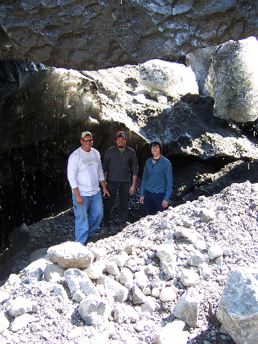 Todd, Rob, and Adam standing in a glacial cave.