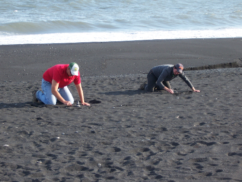 Todd and Rob on the black sand beach.