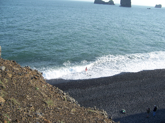 Rob (in the red trunks) searches for the lava source while his comrades (lower right corner) observed his methods.