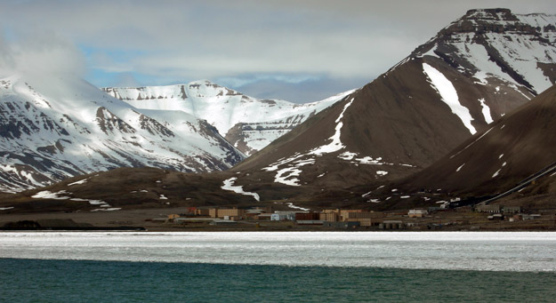 "This is the abandoned Russian coal-mining town of Pyramiden.  We were unable to land there because of the thick pack ice between us and the harbor.  The town was evacuated quickly in 1998 as it became evident it could not survive economically without the subsidies it had received from the Soviet Union.  I wanted to see its ""northernmost statue of Lenin""."