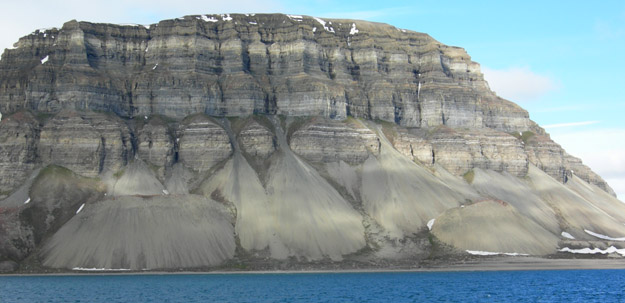 Talus cones along the margin of Tempelfjord.  Can you tell which two cones are not natural?