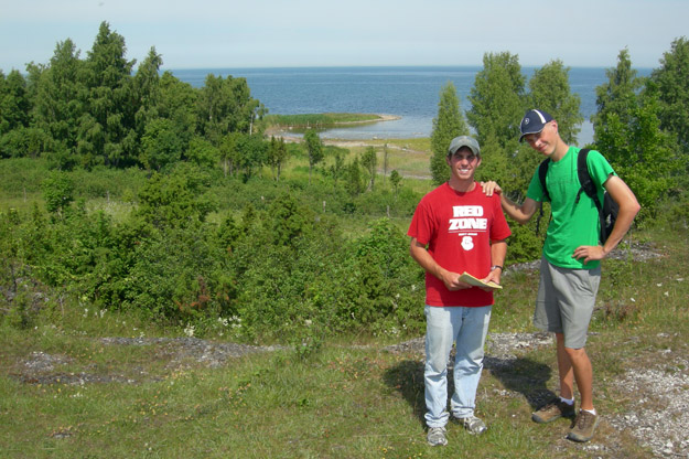 Rob McConnell and Palmer Shonk at the Uugu Cliff locality, Muhu Island, Estonia.  The blue Baltic Sea is in the background.