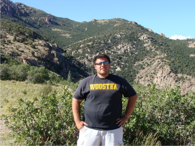 Wooster makes it to the Canyon Range Thrust overlook!  Behind Bill is the famous exposure of the Canyon Range Thrust, where synorogenic conglomerates were deposited at the front of the thrust sheet.  The exposure is located in Oak Creek Canyon in the Canyon Range.
