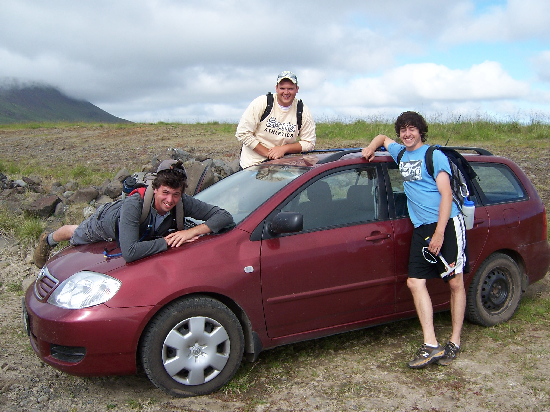 The Woo Crew with our trusty rental car.