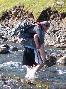 Adam gives Rob a lift across the river.