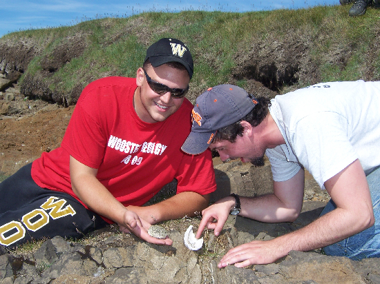 Todd and Rob in the fossil-crouching position on the Skagi shore.