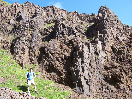 Dikes intruding lavas - Adam for scale.