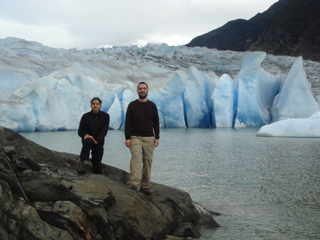 Colin and Kelly standing in front of Mendenhall Glacier. Last year, the ice was where they are standing.