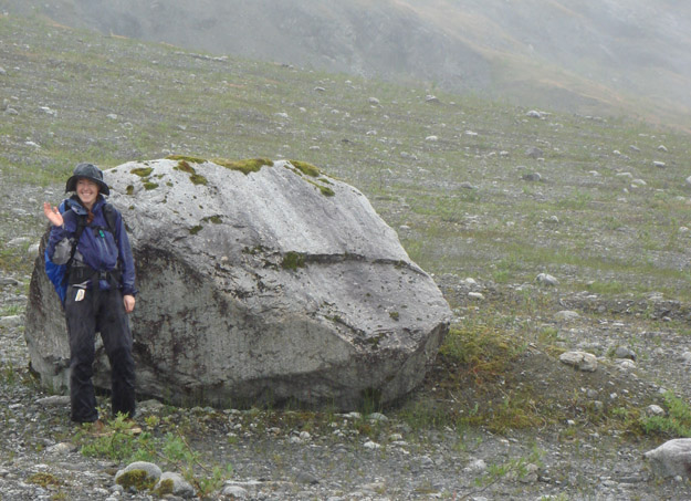 Sarah standing in front of a huge glacial erratic (one that didn't have that far to travel). Notice the sediment in front of it that had been pushed along during the glacier's advance.