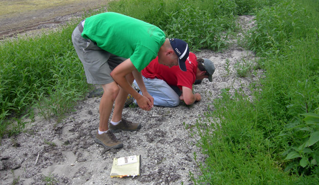 Palmer and Rob in the traditional fossil collecting position.