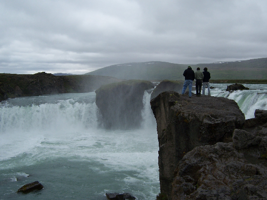 "The Woo Crew stands at the edge of Godafoss, ""waterfall of the gods."""