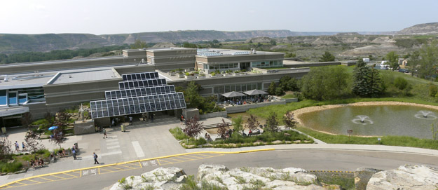 The Royal Tyrrell Museum of Palaeontology sits within a basin with badlands exposures of dinosaur-loaded Late Cretaceous terrestrial sediments.