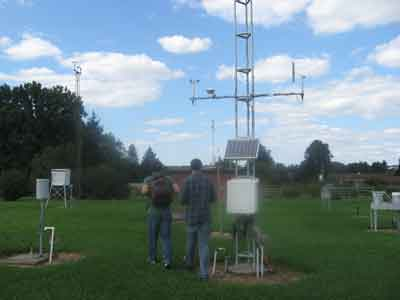 Travis and Adrian at the OARDC Meteorolgical Station. After the class develops tree-ring chronologies they will compare the ring-width series to the long (>100 year) record of monthly temperature and precipitation records from this site.