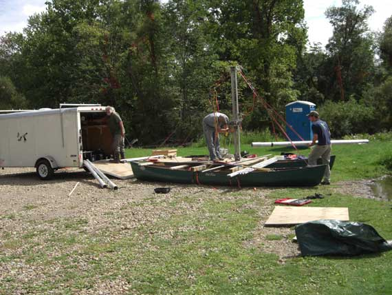 "The first step was to build the raft. Dr. Lowell (aka ""the core boss"") is in the trailer. Bill and Rob assemble the parts and pieces."