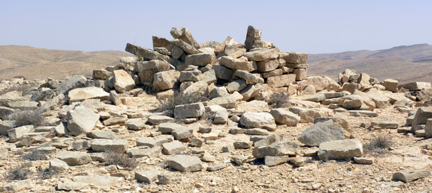 A Bronze Age tumulus (rock-covered grave) at the top of a hill north of Makhtesh Ramon.