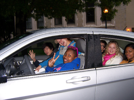 Students piled into one car while waiting leave early on Saturday morning. They eventually squeezed 8 bodies into this vehicle. Talk about a tightly-knit group!