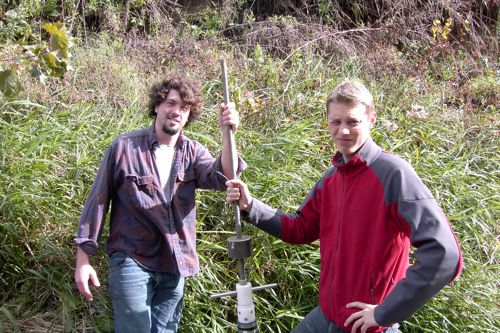 Rob and Palmer pose with coring device that they used to recover a sediment core from the bottom of the Killbuck River where is has downcut into the blue lake clay sediments. The blue clay is the confing layer of the Wooster buried valley aquifer.
