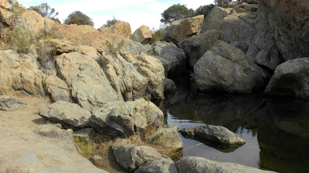 Waterfall (mostly dry) over Jurassic rocks in the Los Peñasquitos Canyon Preserve in San Diego County (N32.92712°, W117.17757°).