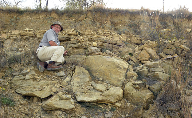 Tom Yancey, a paleontologist at Texas A&M University, seated on our little outcrop of the Valera Formation in West Texas (N31.48454°, W99.69368°).