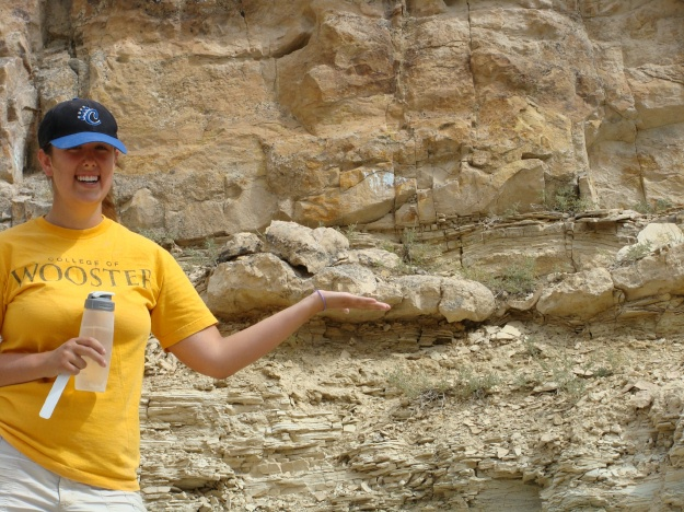 Elizabeth shows her enthusiasm for the silicified stromatolite layer, which is at hand level in this photo.