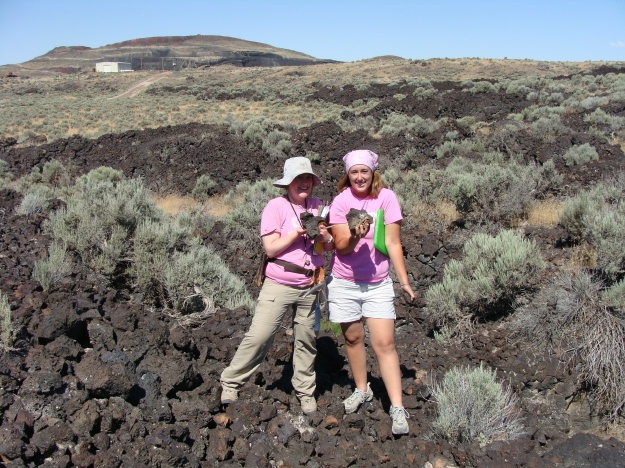 Elyssa Krivicich (left, '09) and Elizabeth Deering (right) proudly display the Utah basalt.  The Red Dome cinder cone is in the background.  Hey Dr. Pollock and Becky Alcorn (our Icelandic Team)...do you like it?