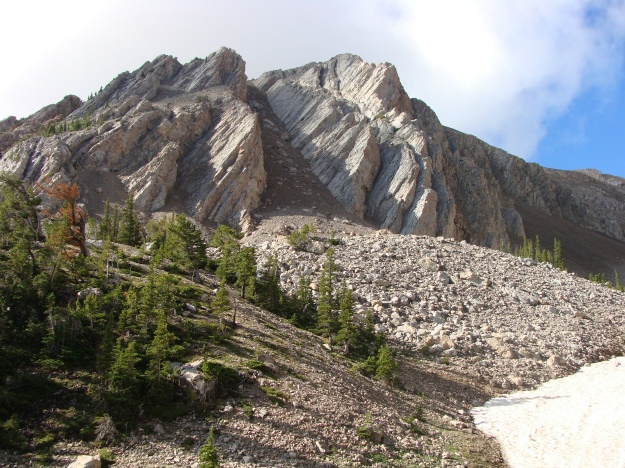 View of the Paleozoic carbonates that are wonderfully exposed along the climb toward Sacagawea Saddle.  This area is in the Gallatin National Forest.  Notice the huge talus pile and the remnant snow in the photo.