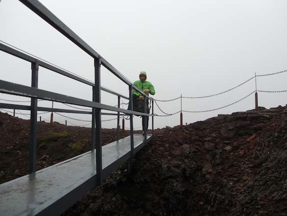 We crossed this bridge to get into the open-air basket that took us into the volcanic chamber. Photo Credit: Ellie Was