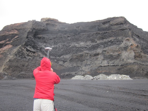 "Aleks ('14, Dickinson) uses a GPS and a laser range finder to ""shoot"" the quarry walls."