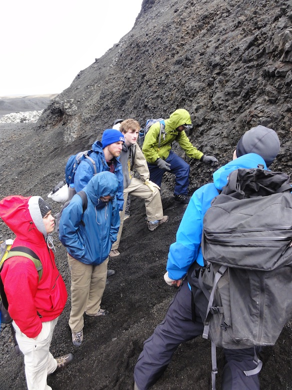 Team Iceland examines the base of a wall of pillow lavas and discusses the formation of hyaloclastite, the glassy fragmental material that spalls off the pillow rims.