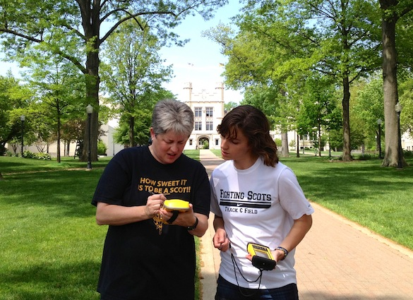 Tricia Hall ('14) and Dr. Shelley Judge work together to map a sidewalk.