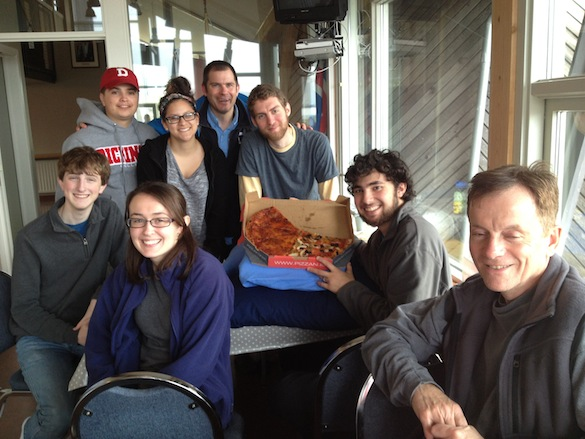 "Team Iceland and their ""Pizza on the Pillows"" in the dry hostel dining room. Pictured from left to right: Michael ('16, Wooster); Aleks ('14, Dickinson); Ellie ('14, Dickinson); Liz ('16, Dickinson); Dr. Ben Edwards; Alex ('14, Wooster); Adam ('16, Wooster); Jim Ciarrocca (GIS, Dickinson)."
