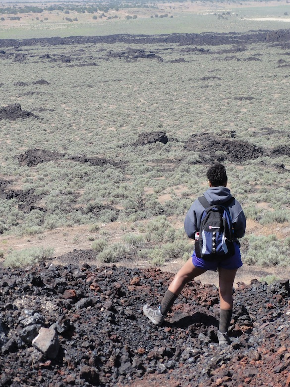 Candy Thornton ('14) contemplates her field area. She'll be documenting features in the lava flows to determine whether they inflated as they were emplaced.