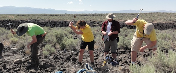 Synchronized hammering was the only way we could get samples of the tough lava. From left to right: Cam Matesich, Ellen Redner ('14, Albion), Kyle Burden ('14, Wooster), and Ben Hinks. Credit: M. Pollock