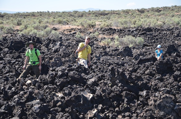 Cam Matesich ('14, Wooster), Ben Hinks ('14, Albion, and Tricia Hall ('14, Wooster) looking for samples in an 'a'a lava flow in Cam's field area. Credit: T. Wilch