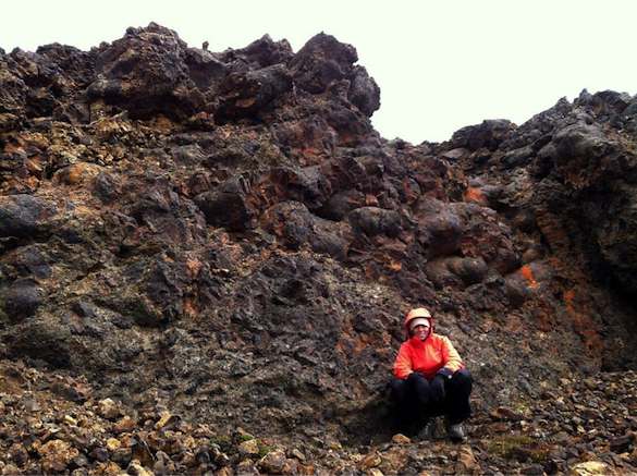 Photo credit to Liz P; A nice pillow exposure interlaid with tuff breccia on Pillow Ridge, with Julia F. for scale.