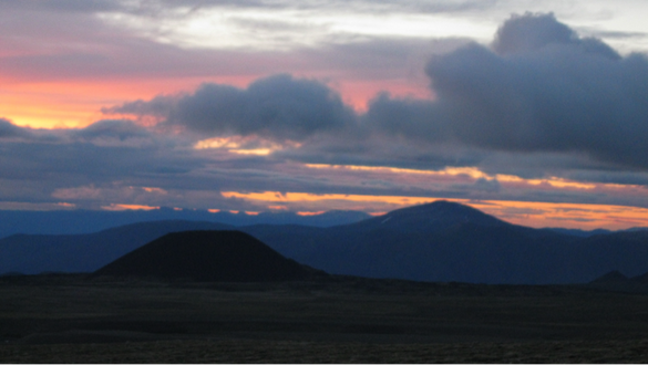 Photo credit: Julia F; A sunset view from basecamp. Pictured on the horizon is Eve Cone, one of the youngest cinder-cone volcanoes in the provincial park.