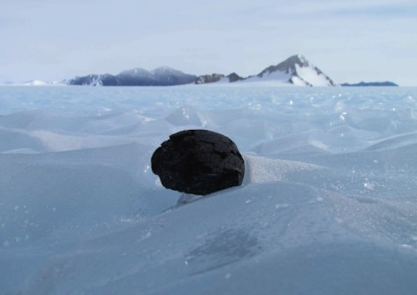 Image of meteorite, exhibiting fusion crust, in Antarctica.  Photo from: https://earthandsolarsystem.wordpress.com/2013/01/21/ansmet-meteorite-hunting-2012-2013-season-draws-to-an-close/