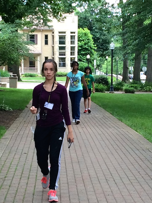 B-WISER girls focus intently on measuring distances on the academic quad with their paces.