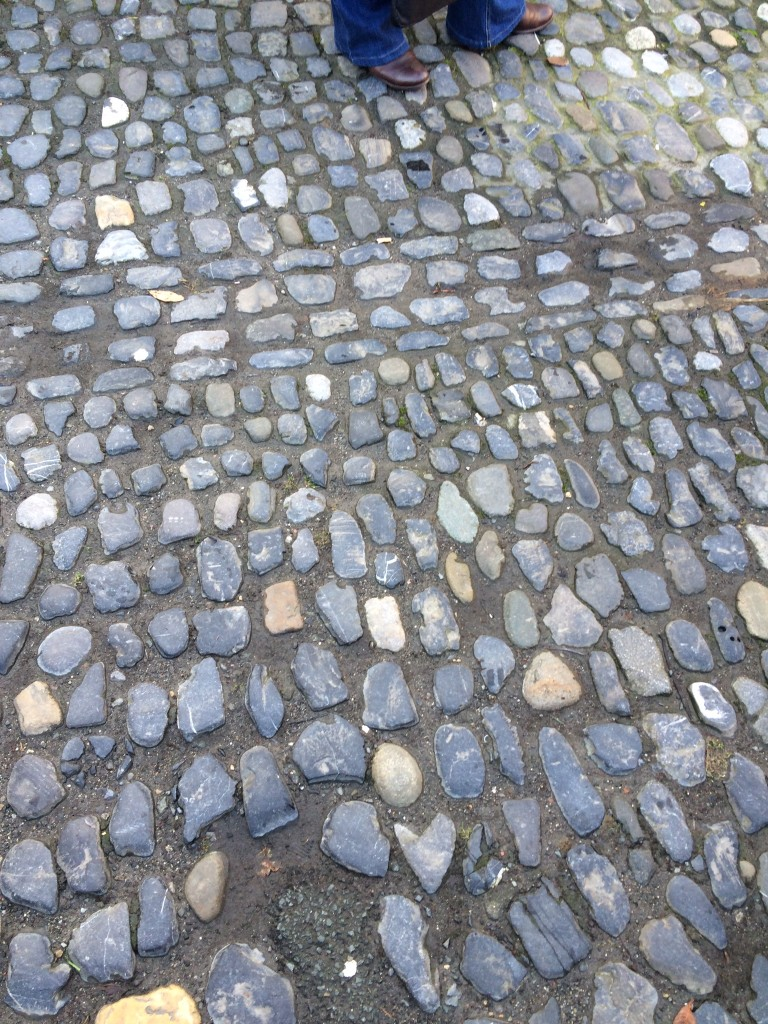 The floor of the square is paved with polished glacial cobbles of a variety of lithologies, including limestone and andesite.