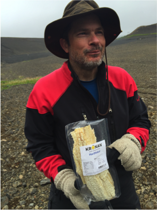 Ben with Harðfiskur. The dried fish has an incredibly potent smell that we cannot get out of the van.