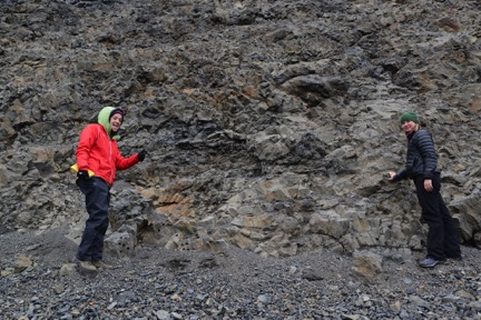 Michelle Orden and Anna Thompson with a shelved lava tube in the Undirhlíðar quarry. The tube was likely refilled with the darker lava.