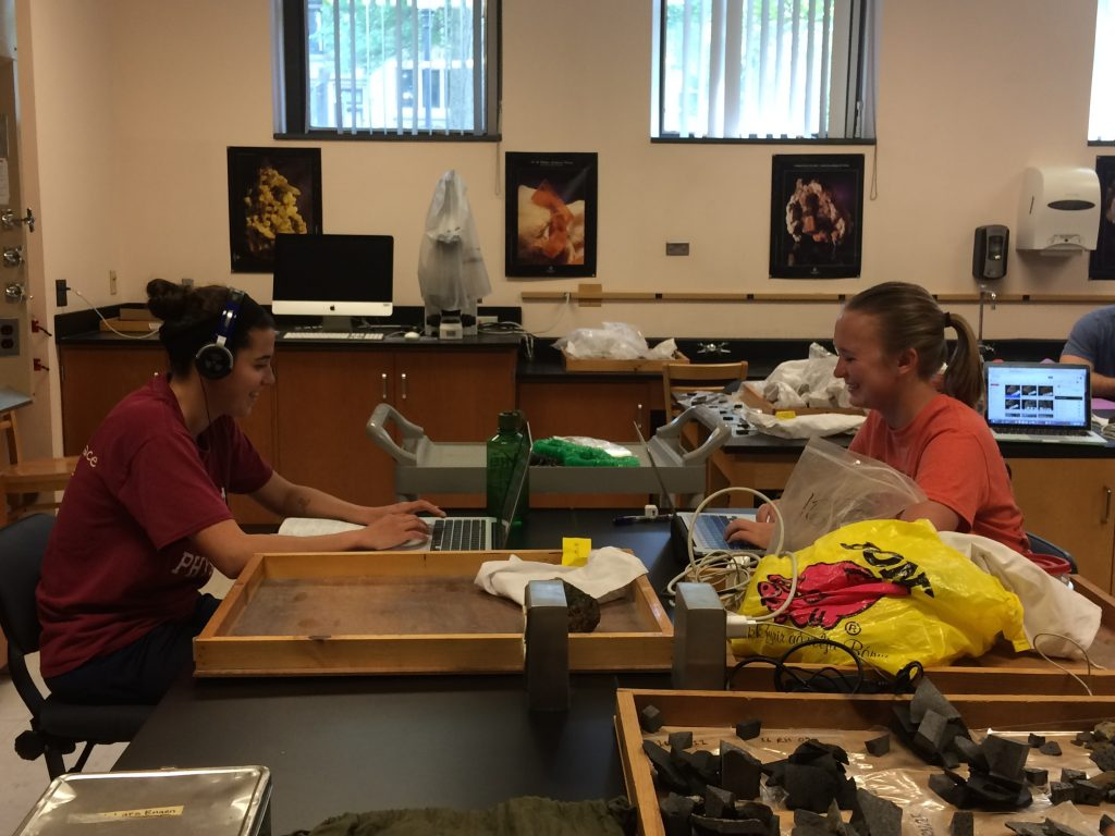 Lab work entails more than physical preparation of samples. Michelle Orden ('17, Dickinson College) and Anna Thompson ('17, Carleton College) are analyzing high-resolution photos of pillow lavas to understand the physical volcanology.