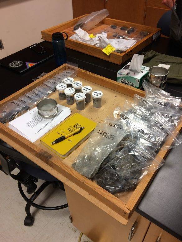Every student has a project box in which they're keeping all of their materials. Rachel's is organized with thin section billets on the left, powders in the middle, and pieces to archive on the right.